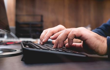 Male Hands Working On Computer Keyboard On WorkingTable In Office