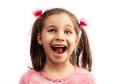 Close Up Portrait Of A Laughing Child Girl With Shallow Depth Of Field, Isolated On White Background