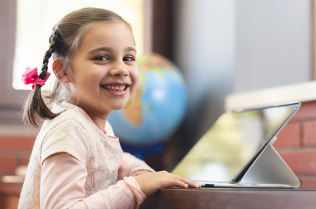 Happy Little Child Girl Using Digital Tablet Stock Photo