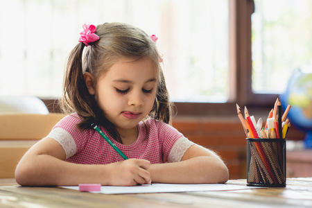 Happy Little Child Girl Drawing Picture in School