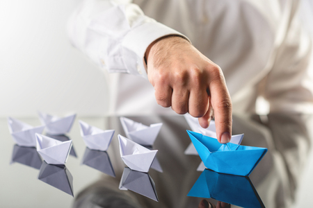 Leadership Concept with Businessman and Paper Ship