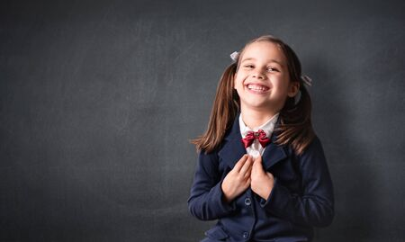 Back To School Concept, Portrait of Happy Smiling Child Student at Balckboard Stock Photo