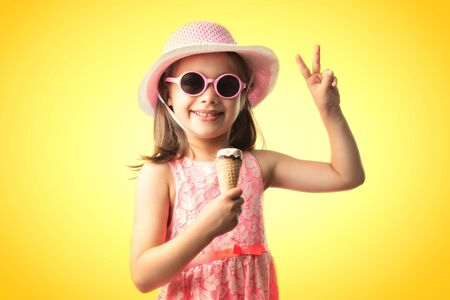 Happy Child Girl Eating Ice Cream, Summer Concept Stock Photo