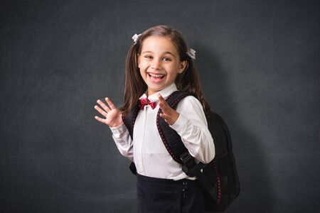 Back To School Concept, Portrait of Happy Smiling Child Student at Blackkboard