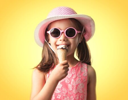 Happy Child Girl Eating Ice Cream, Summer Concept Stock Photo - 127242260