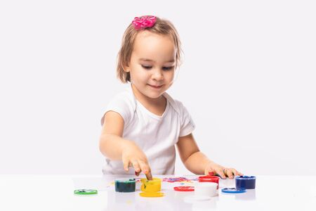 Portrait of  Little Child Girl Playing with Finger Paints Imagens