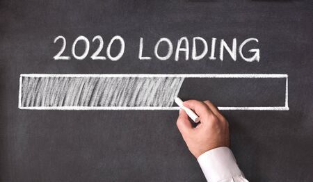 New Year Business Concept. 2020 Loading, on Blackboard