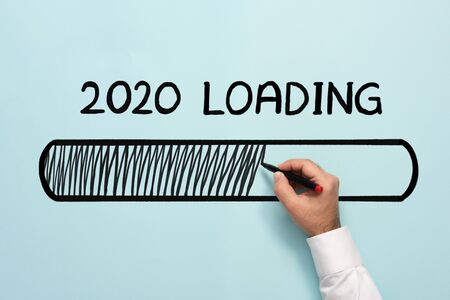 New Year Business Concept. 2020 Loading, on Light Blue Background