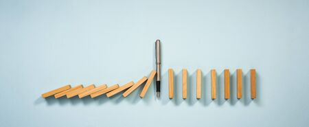 Chain Reaction In Business Concept, Pen Intervening Chain Dominoes Toppling Stock fotó
