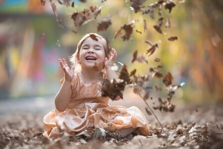 Portrait of Little Child Girl in Autumn in Nature Park Stock Photo - 132259507