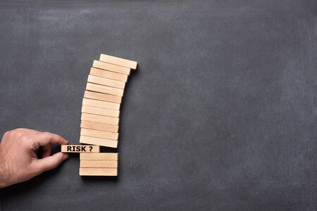 Risk Management Metaphor with Wooden Blocks, Business Concept Stock Photo - 133316515