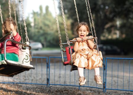 Little Child Girl Playing At Playground Outdoors Stock Photo - 133316518