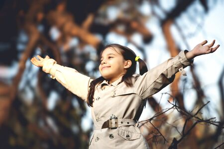 Portrait of Little Child Girl in Autumn in Nature Park Stock Photo - 133316519