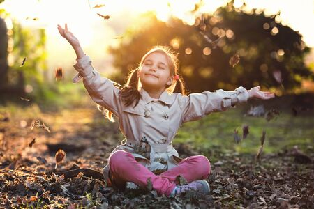Portrait of Little Child Girl in Autumn in Nature Park Stock Photo - 132955364