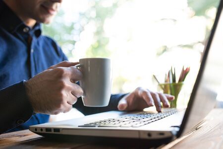Man Working And Drinking Coffee In Office Stock Photo - 132531275