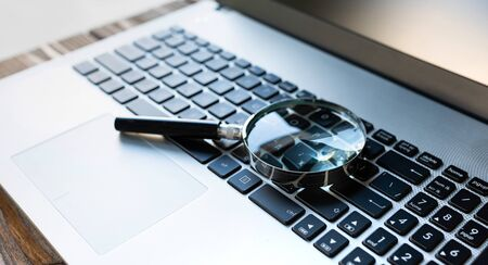 Concept For Searching On Internet, Magnifier On Computer Keyboard Stock Photo - 132530620