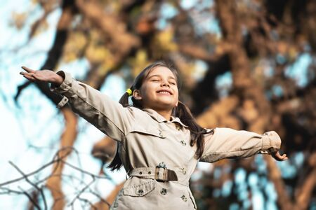 Portrait of Little Child Girl in Autumn in Nature Park Stock Photo - 132974691