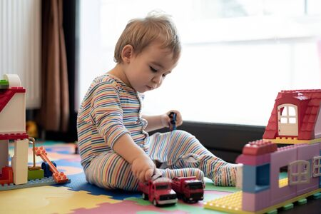 Happy Baby Boy Playing with Toys At Home Stock Photo - 132974549