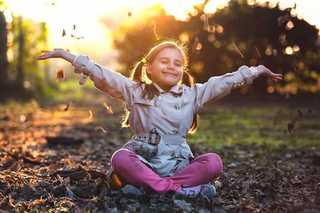 Portrait of Little Child Girl in Autumn in Nature Park Stock Photo - 132975545