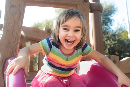 Little Child Girl Playing At Playground Outdoors In Summer Stock Photo - 132974795