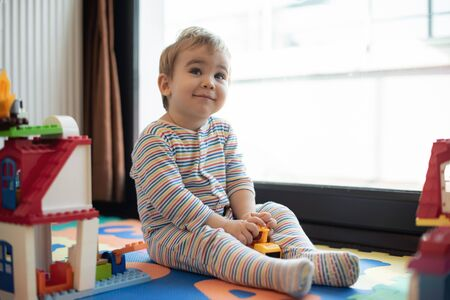 Happy Baby Boy Playing with Toys At Home Stock Photo - 132974683