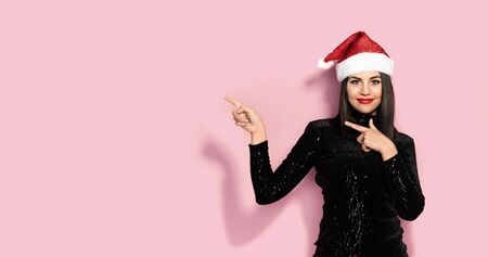Breautiful Brunette in Black with Christmas Celebration Hat, Available Copy Space Stock Photo - 133562204
