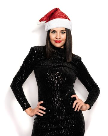 Beautiful Brunette in Black with Christmas Celebration Hat Stock Photo - 133562210