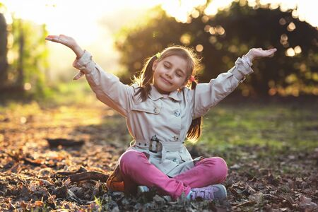 Portrait of Little Child Girl in Autumn in Nature Park Stock Photo - 133562205