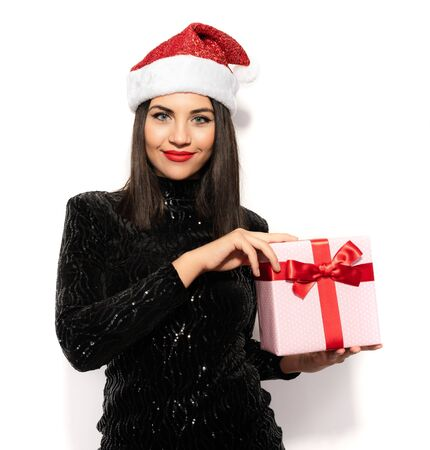 Beautiful Brunette in Black with Christmas Celebration Hat, Gift Concept Stock Photo - 133562211
