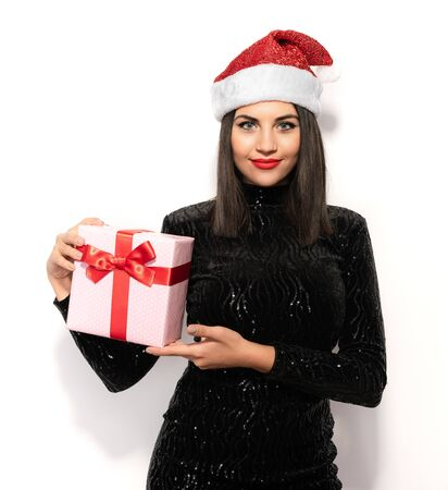 Beautiful Brunette in Black with Christmas Celebration Hat, Gift Concept Stock Photo - 133562212