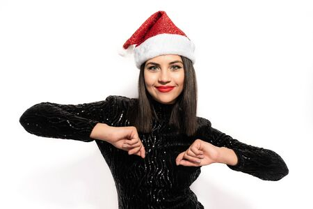 Beautiful Brunette in Black with Christmas Celebration Hat Stock Photo - 133562213