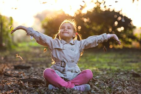 Portrait of Little Child Girl in Autumn in Nature Park Stock Photo - 133562221