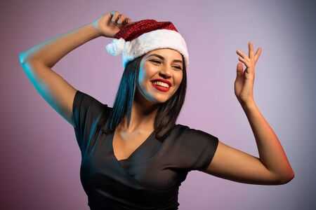 Beautiful Brunette Woman in Black with Christmas Celebration Hat