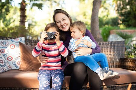 Happy Family with Children Enjoying Time Together Outdoors Stock Photo