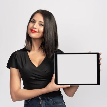 Beautiful Brunette Woman in Black Holding Digital Tablet with Copy Space Stock Photo - 135461011
