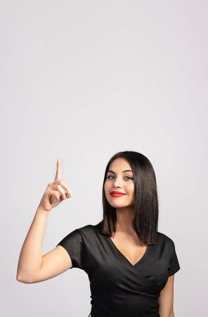 Portrait Of Beautiful Brunette Woman Gesturing with Available Copy Space Stock Photo - 137337985