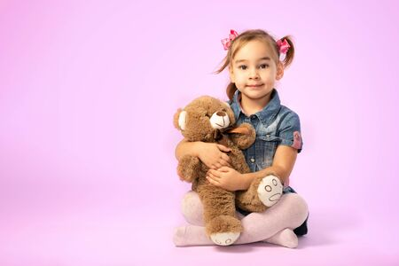 Portrait of Child Girl Hugging Her Soft Toy Bear Stock Photo - 137337989