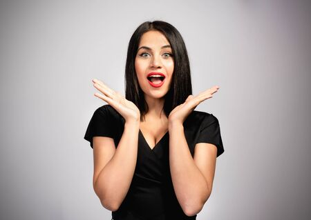 Portrait Of Beautiful Brunette Woman Gesturing with Available Copy Space Stock Photo - 137337987