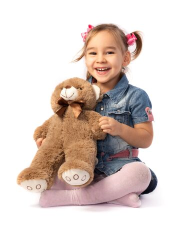 Portrait of Child Girl Hugging Her Soft Toy Bear Stock Photo - 135556394