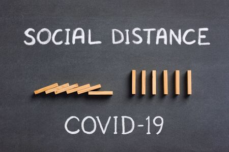 Keep Social Distance Concept, Covid-19 Domino Effect is Stopped. Stock Photo