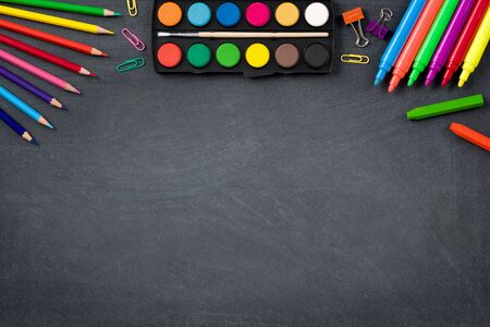 Back to School Concept with Stationery Supplies and Blackboard Stock Photo - 149178059