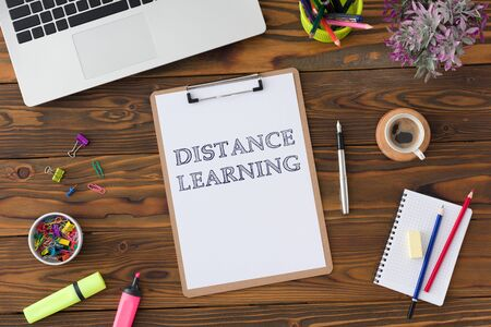 Distance Learning Concept With Stationery Supplies And Computer On Desk