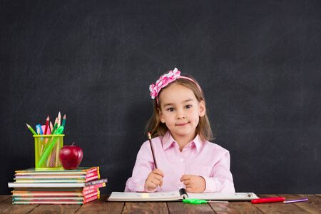 Back To School Concept, Happy Smiling Child Student Studying Stock Photo - 150233084