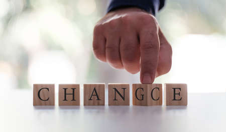 Businessman Flipping Over The Word Chance to Change or Vice Versa. Business Motivation Concept