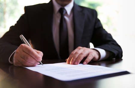 Businessman Signing Contract or Legal Papers