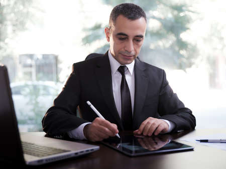 Businessman Signing Digital Contract On Tablet Using Stylus Pen