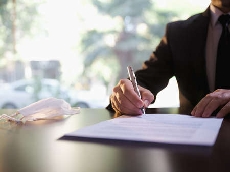 Businessman Signing Contract or Legal Papers, Bisiness and Covid-19 Concept