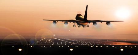Vliegtuigen die bij zonsondergang