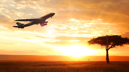 airplane at sunset departure