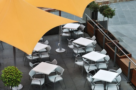 Orange umbrellas covering tables in cafeteria photo